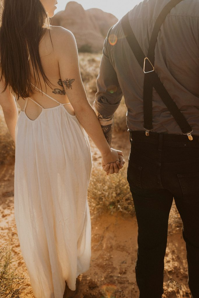Bride and groom holding hands at their Arches National Park, UT elopement
