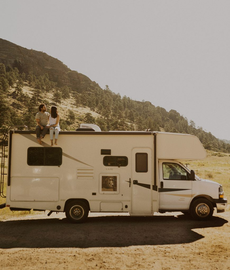 A couple sitting on their RV in Rocky Mountain National Park, CO