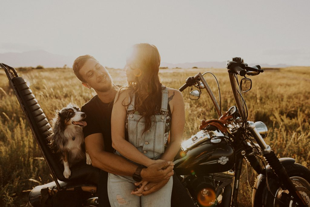 a couple and their dog riding their motorcycle during their Red Rock Canyon, CO couples session