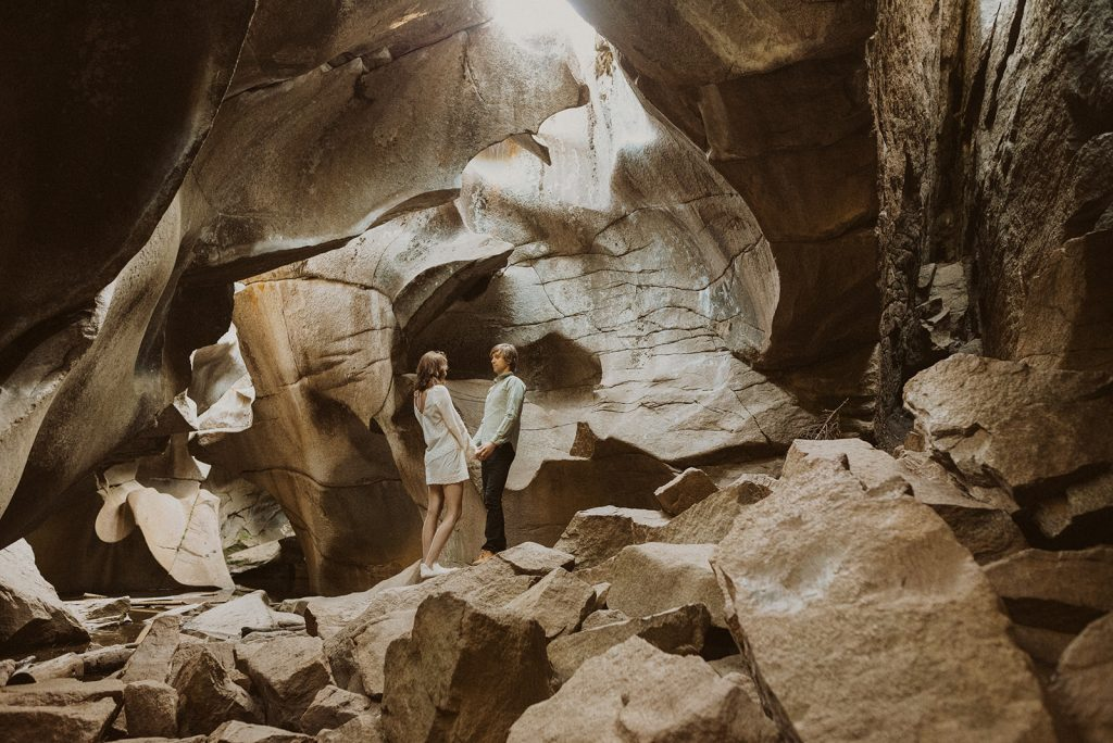 A bride and groom exploring ice caves during their elopement