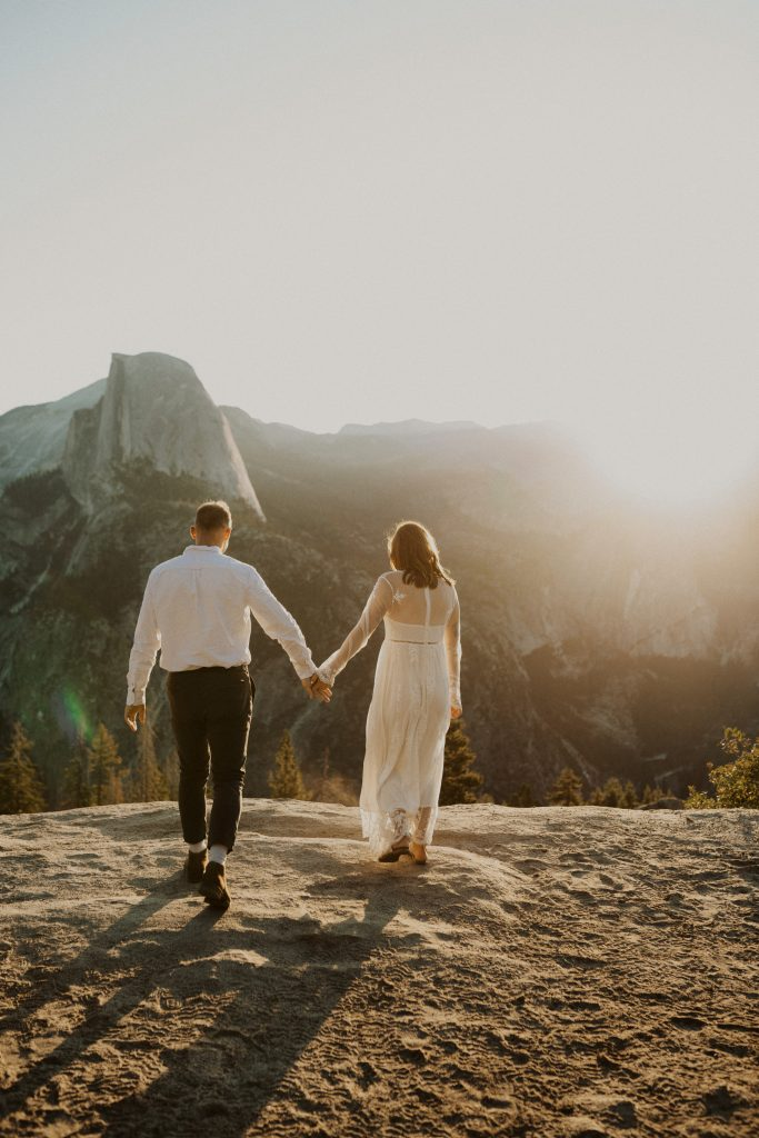 A bride and groom at Glacier Point in Yosemite for their elopement