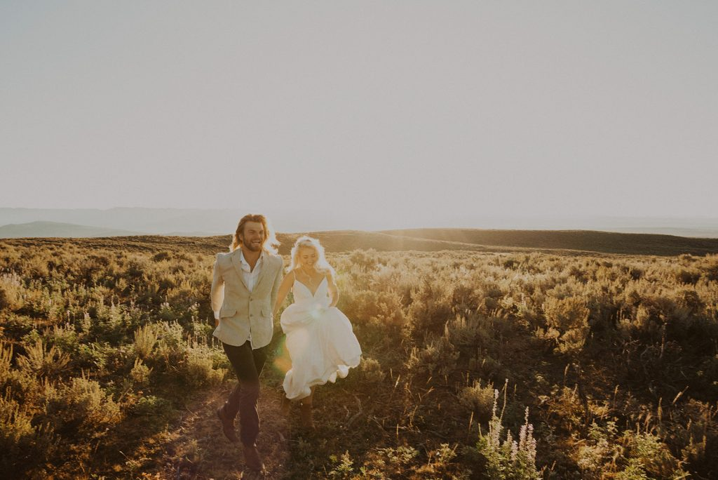 A bride and groom laughing during their jackson hole wyoming vow renewal