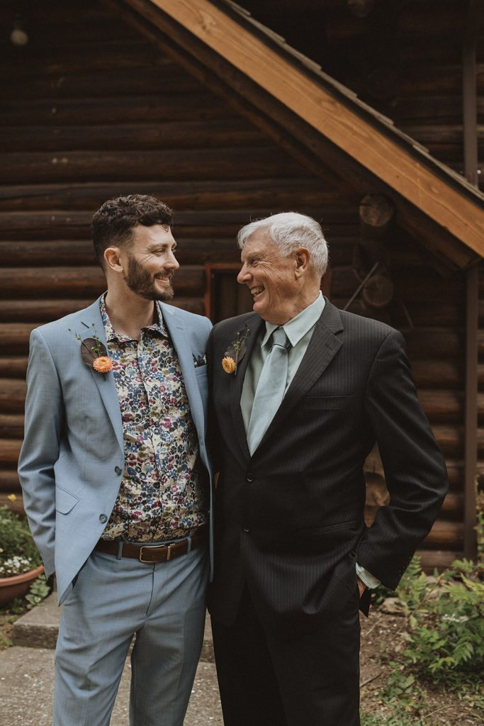 A groom and his father during their Washington coast intimate wedding.