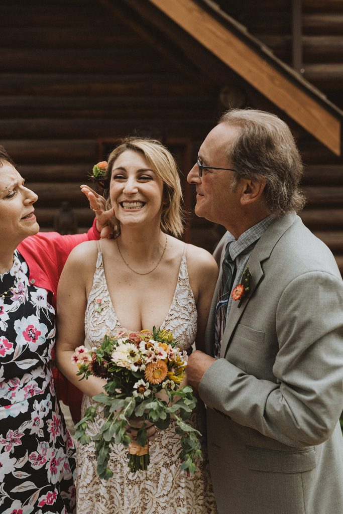 A bride and her parents during her Seattle, WA intimate wedding